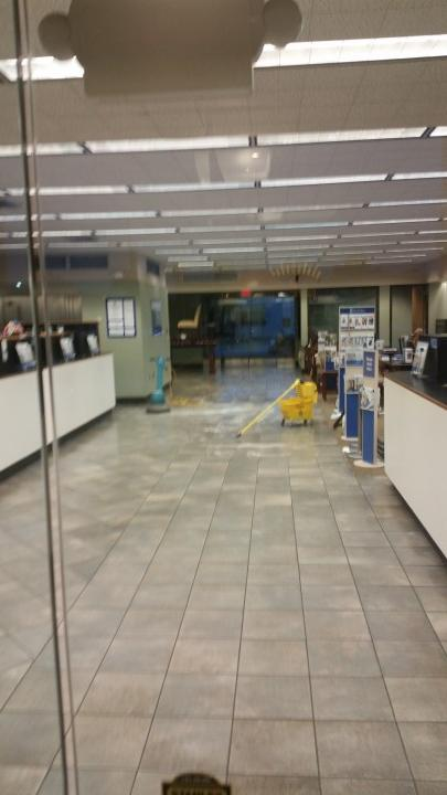 BCG Management janitor in Golden Meadow LA mopping floor.